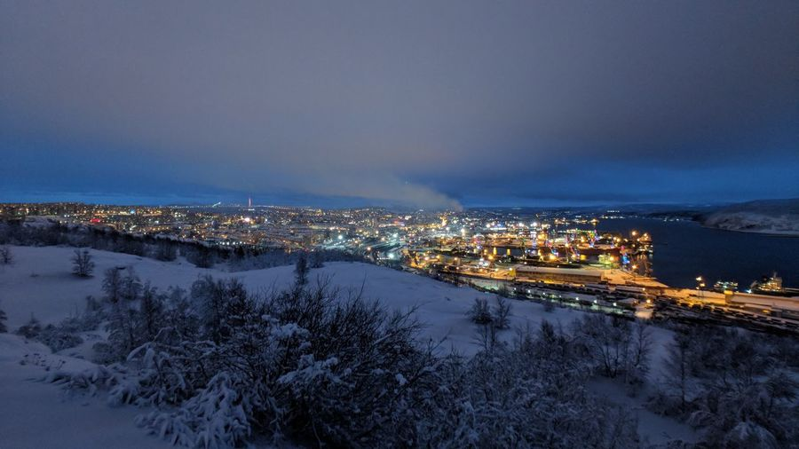 High Angle View Of Illuminated Cityscape During Winter