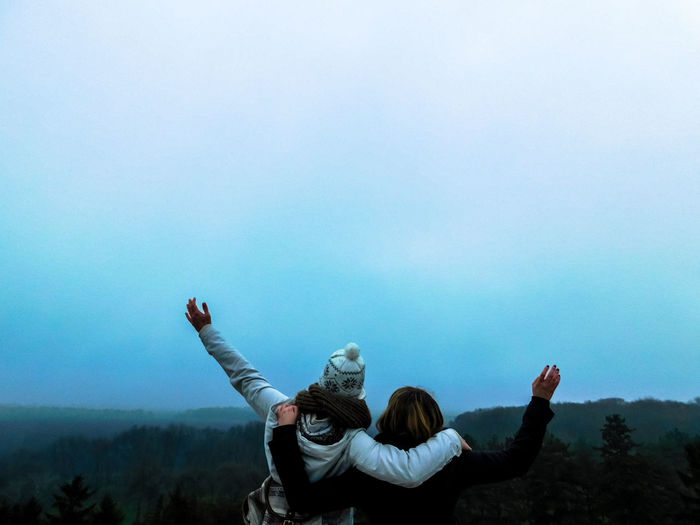 Arms Raised Beauty In Nature Clear Sky Day Friendship Human Hand Leisure Activity Lifestyles Love Men Nature Outdoors People Real People Sky Togetherness Tree Two People Women Young Adult Young Women