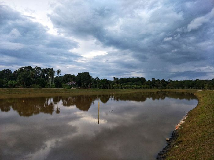 the clouds and the reflection in the lake EyeEm Selects Reflection Water Lake Cloud - Sky Nature Tree No People Outdoors Sky Beauty In Nature Landscape