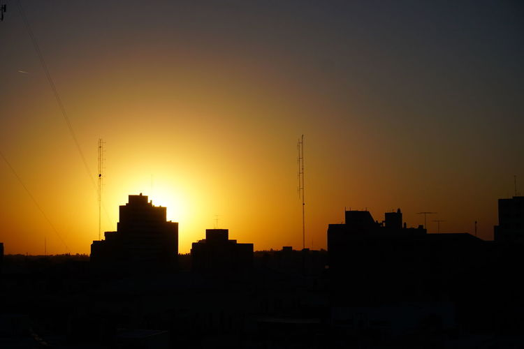 El amanecer en la ciudad de Río Cuarto, Córdoba, Argentina. Architecture Building Exterior Built Structure City Cityscape Development Modern Nature No People Orange Color Outdoors Silhouette Sky Skyscraper Sunset Travel Destinations Urban Skyline