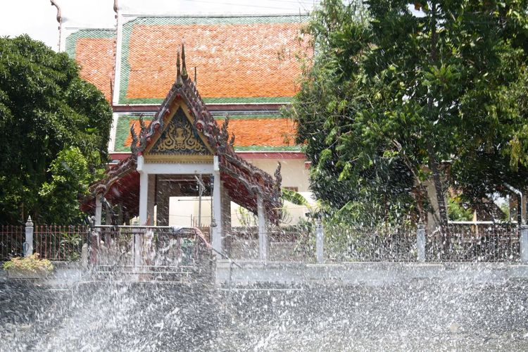 Water splashing in river against traditional building