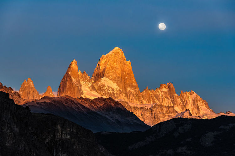 Scenic view of mountains against clear sky at night