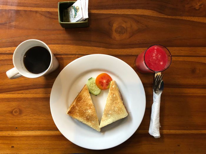 INDONESIA Bread Breakfast Coffee Coffee Cup Crockery Drink Food Food And Drink Freshness Glass Healthy Eating High Angle View Indonesia Photography  Indonesia Photography  Indoors  Kitchen Utensil Meal Mug No People Plate Ready-to-eat Refreshment Still Life Wood - Material
