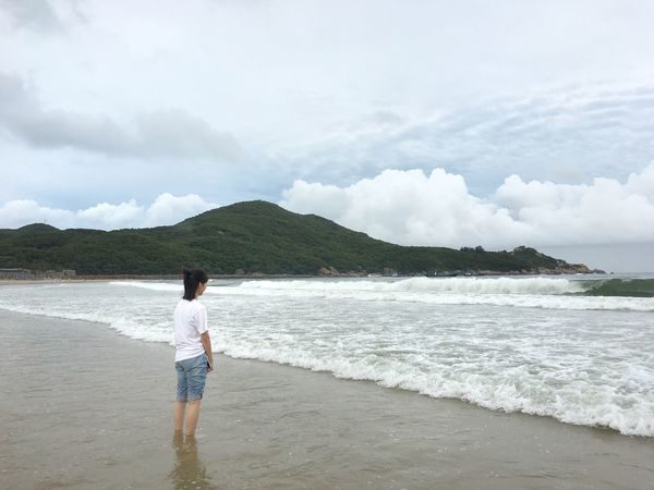 Sea Sky Rear View One Person Real People Beach Full Length Cloud - Sky Nature Standing Mountain Beauty In Nature Sand Water Wave Day Scenics Leisure Activity Outdoors Lifestyles