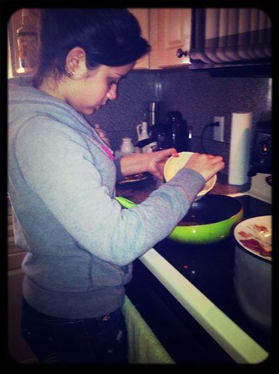 Her making pancakes
