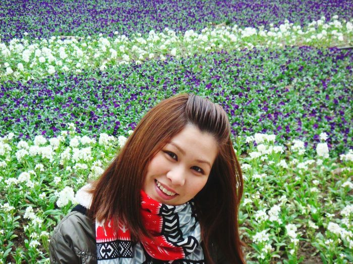 Portrait of smiling young woman wearing scarf