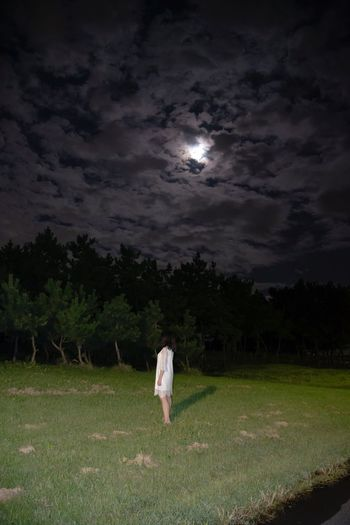 Lost In The Landscape Grass Night Field Sky Full Length Standing Nature Cloud - Sky Outdoors One Person Tree Growth Real People People