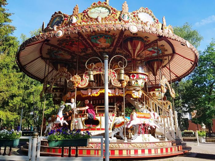 Carusel Amusement Park Arts Culture And Entertainment Carousel Amusement Park Ride Merry-go-round Carousel Horses Enjoyment Outdoors Turning Fun Day Leisure Activity No People Sky
