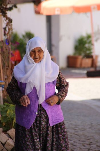 Happily Ever After Travel Sığacık Izmir Turkey Happily Ever After Woman Old Happiness Looking At Camera Smiling Real People Senior Adult One Person Outdoors Day Lifestyles EyeEm Nature Lover Standing Eye4photography  EyeEm Best Shots Front View Senior Women Adult