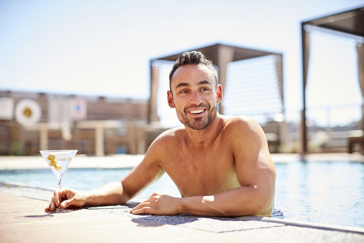 Portrait of smiling man in swimming pool