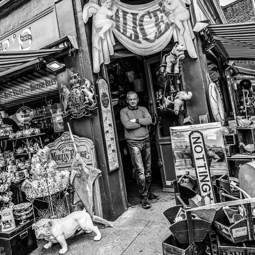 """""""The Guardian of Wonderland"""" EyeEm Best Edits EyeEm Best Shots EyeEm Best Shots - Black + White EyeEm Selects EyeEm Gallery EyeEmNewHere Notting Hill Choice Day Eyeemphotography For Sale Full Length Indoors  Large Group Of Objects Love Yourself Market One Man Only One Person People Real People Retail  Street Street Photography Streetphotography Variation The Street Photographer - 2018 EyeEm Awards My Best Photo British Culture"""