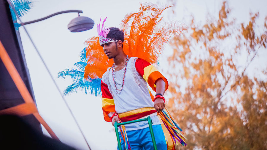 Low angle view of young man in costume