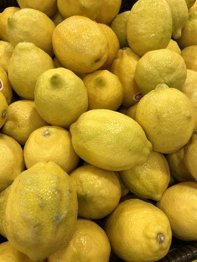 Full Frame Shot Of Lemons For Sale In Market