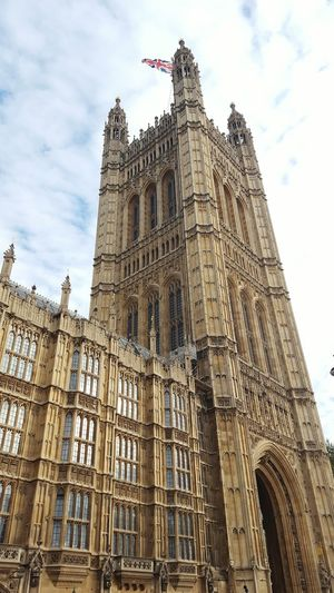 Houses of Parliament, London Architecture Building Exterior Low Angle View Sky History Gothic Style Tower Façade Famous Place Parliament London Houses Of Parliament Samsung Galaxy S6 Mobile Photography Architectural Feature City Flag Union Jack London Lifestyle EyeEm LOST IN London