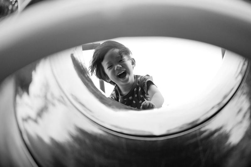 JOY Blackandwhite Childhood Front View Fun Happiness Joy Kid Leisure Activity Lifestyles Looking At Camera Person Playground Portrait Relaxation Smile The Portraitist - 2016 EyeEm Awards