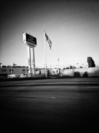 Text Information Sign No People Outdoors Day Sky Freeway Freewayphotography Freeway Sign Signs Flag American Flag Starspangledbanner On The Road Driving Car CarRide City Life City Street City Boomers Friends Welcome To Black Blackandwhite Fun The Street Photographer - 2017 EyeEm Awards