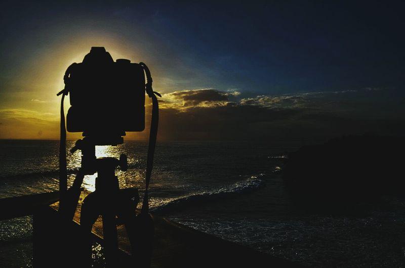 Camera on tripod near beach