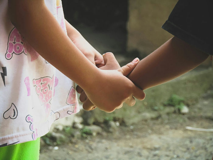 Close-up of girl holding hands