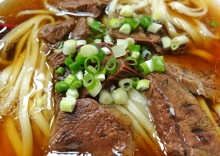 Taiwan beef noodle soup with chives Taiwan Food Beef Beef Noodle Soup Broth Chives Close-up Food Food And Drink Healthy Eating Leeks Meat Noodle Soup Ready-to-eat Soup