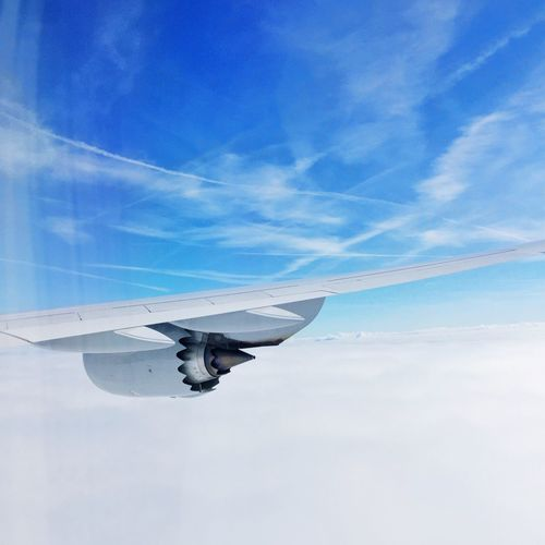 Flying Airplane Wings Clouds Sky Above The Clouds Blue