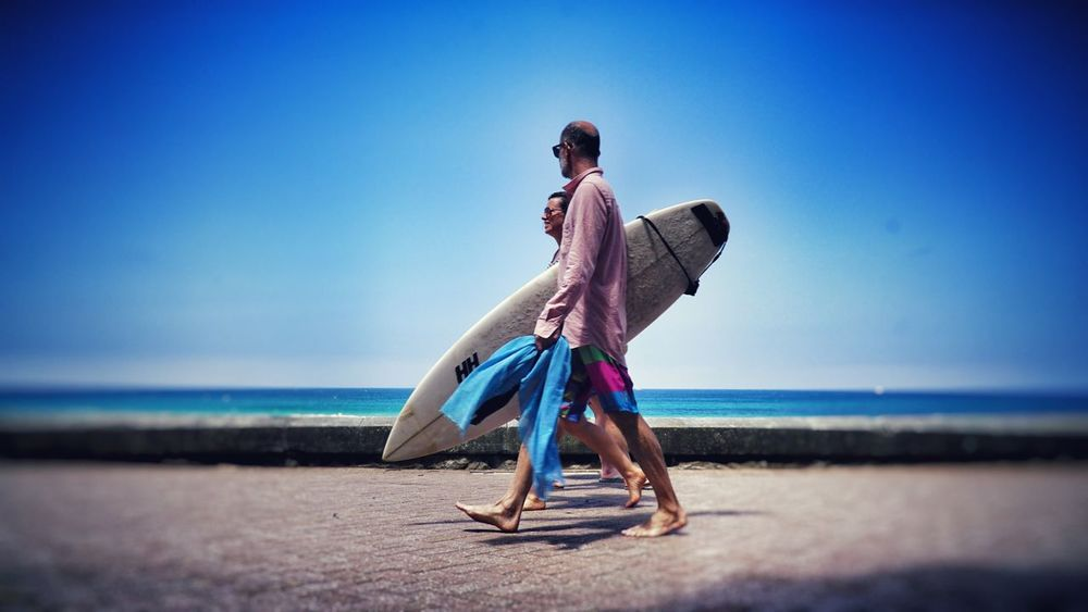 Beach Day Surfing Surfer Sea Horizon Over Water Beach Water Full Length Clear Sky Real People Blue Outdoors People Sand Day Sky
