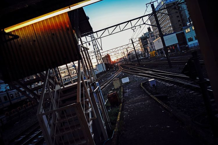 Evening Light Railway Track Railway Built Structure Building Exterior Sky No People Building Nature Fence City