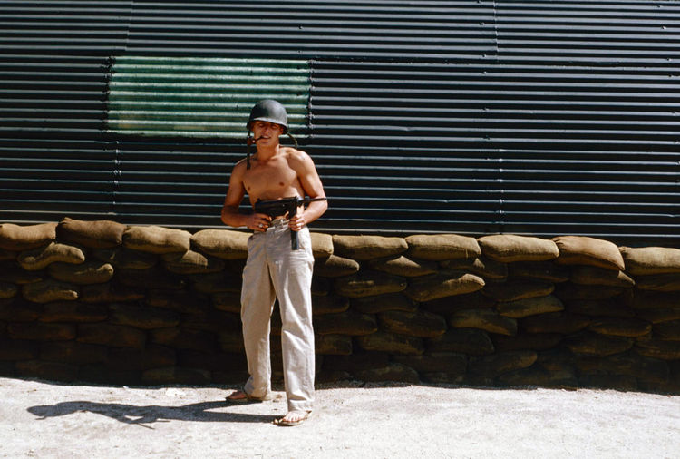 GI Joe 1954 GI Joe South Korea Architecture Built Structure Day Front View Full Length Iron Leisure Activity Lifestyles Looking Looking At Camera Males  Men One Person Outdoors Portrait Real People Shirtless Shorts Standing Wall - Building Feature Young Adult Young Men