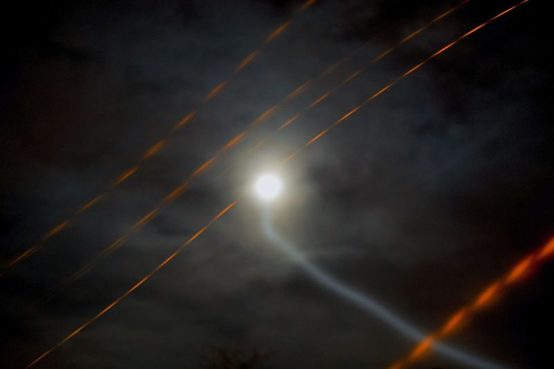 Low angle view of illuminated sky at night