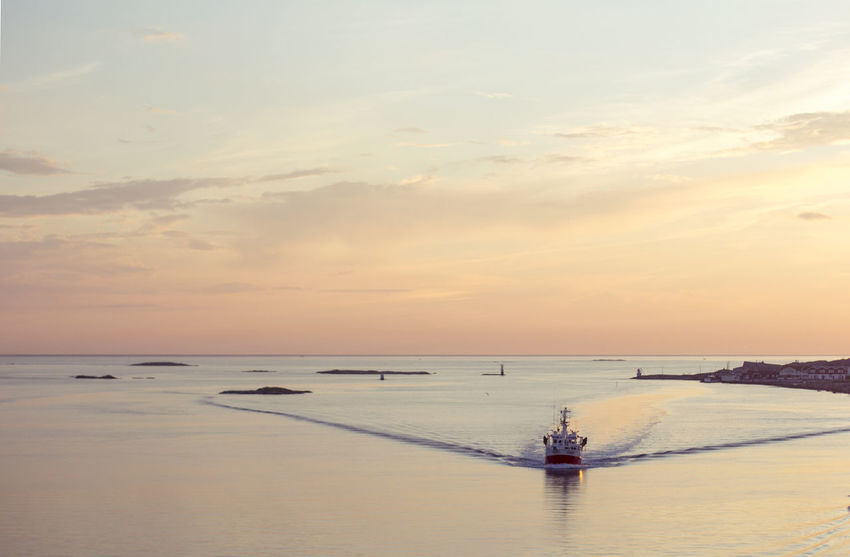 43 Golden Moments Beauty In Nature Boat Boats Goteborg Gothenburg Horizon Over Water Idyllic Landscape No People Non-urban Scene Ocean Orange Color Outdoors Remote Scenics Sea Sunset Sunset_collection Sverige Sweden Tranquil Scene Tranquility Vessel Water Colour Your Horizn