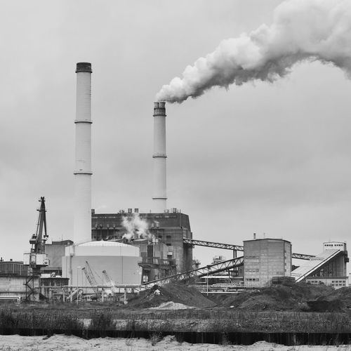 Chimney Chimneys Industry Smoke Air Pollution Architecture Building Exterior Built Structure Chimney Chimney Bricks Chimney Stacks Clear Sky Day Emitting Factory Factory Building Fumes Industry No People Outdoors Pollution Power Station Sky Smoke - Physical Structure Smoke Stack