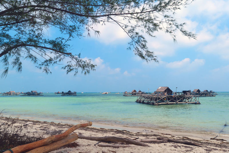 Kelong Fisherman Fishing Daylight Landscape Nature Sea Beach Island Sand Water Vacations Tropical Climate Idyllic Tree Nature Travel Destinations Horizon Over Water Travel Arrival Landscape Relaxation Blue Tranquility Cloud - Sky Sky Scenics Beauty In Nature Nautical Vessel Tranquil Scene