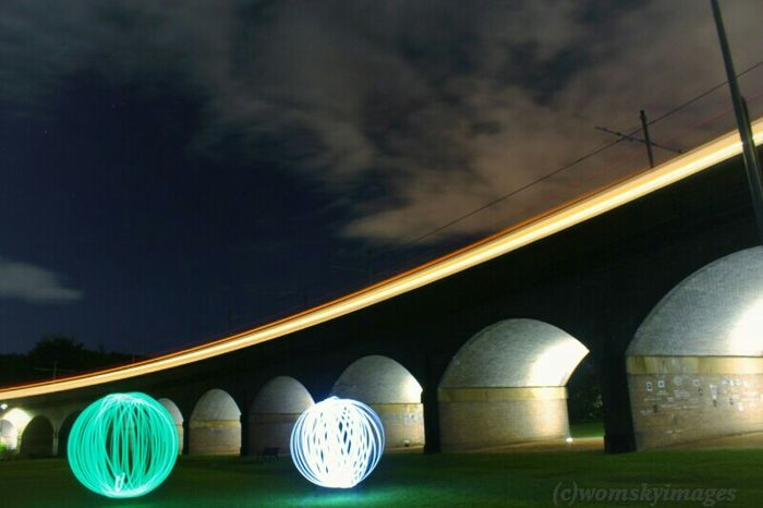 Orbs under a bridge with a train going byCreative Light And Shadow Showcase: January Taking Photos Lightpainting EyeEmBestPics EyeEm Best Shots Artofvisuals Lightplay Lightpaintingphotography Lightpainting_photography