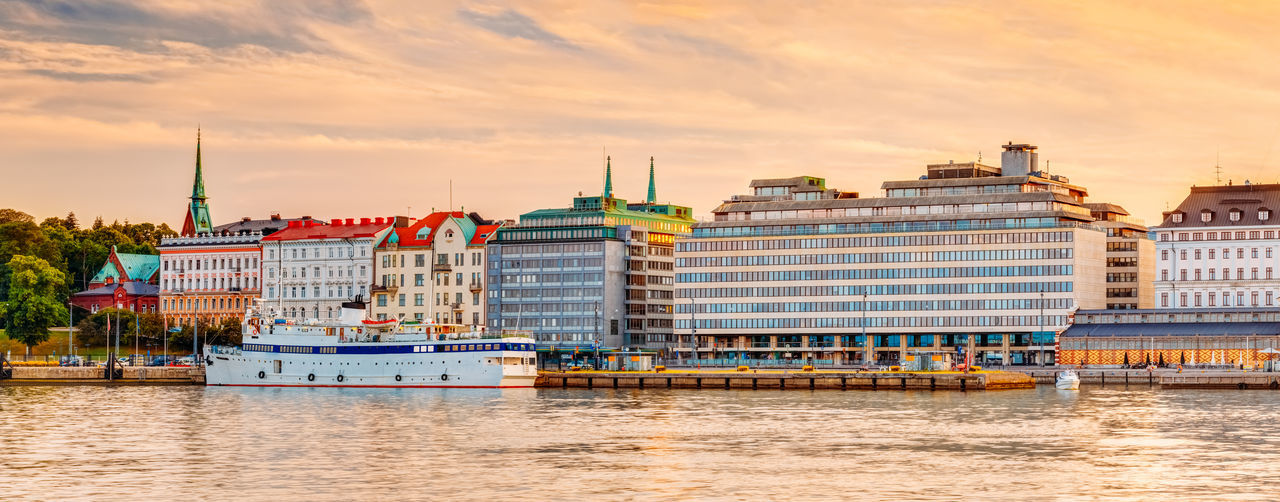 Panorama Of Embankment In Helsinki At Summer Sunset Evening, Sunrise Morning, Finland. Town Quay, Famous Place City EyeEmNewHere Helsinki Sunset_collection Travel Travel Photography Trip Architecture City Cloud - Sky Embankment Europe Finlnd Sky Street Summer Sunrise Sunset Tourism Town Travel Destinations