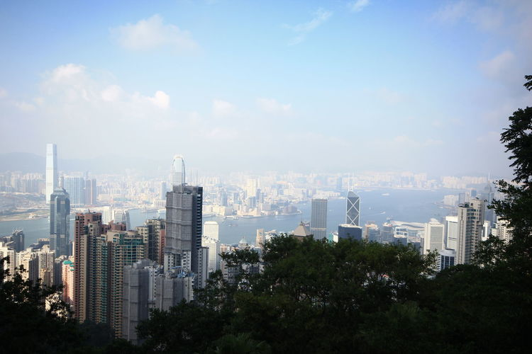 Travel Kowloon in Hong Kong, The Peak mountain see the High building. Building Exterior Built Structure City Architecture Cityscape Sky Building Office Building Exterior Skyscraper Nature Modern Tree No People Cloud - Sky Day Urban Skyline Outdoors Tall - High Tower Residential District Financial District  Pollution