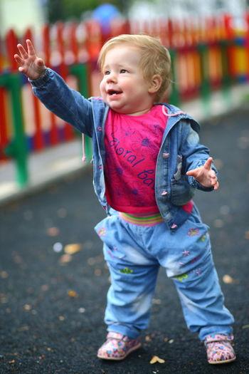 Full length of cute baby girl standing on road