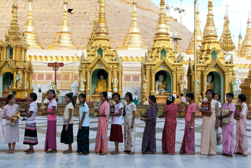 Pagoda Yangon Adult Architecture Building Exterior Built Structure Burma Day Full Length Large Group Of People Lifestyles Men Myanmar Outdoors People Place Of Worship Real People Religion Shwedagon Sitting Spirituality Statue Traditional Clothing Travel Destinations Women