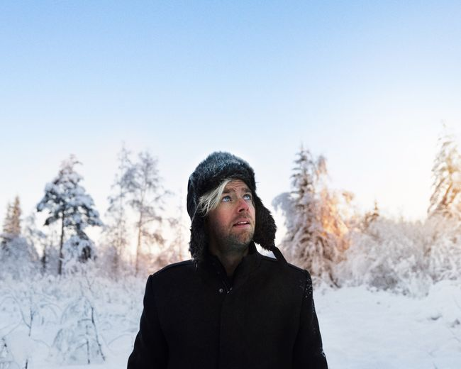 Winter wonderland 🧡 Explore Adventure Beauty In Nature SONY A7ii 35mm Woods Cold Eyeemmarket BestofEyeEm Winter Snow Cold Temperature One Person Warm Clothing Young Adult Tree Portrait Nature Sky Young Men Headshot Lifestyles Outdoors