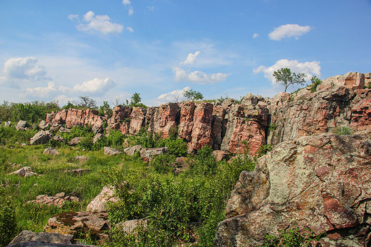 Rock formations on landscape during sunny day