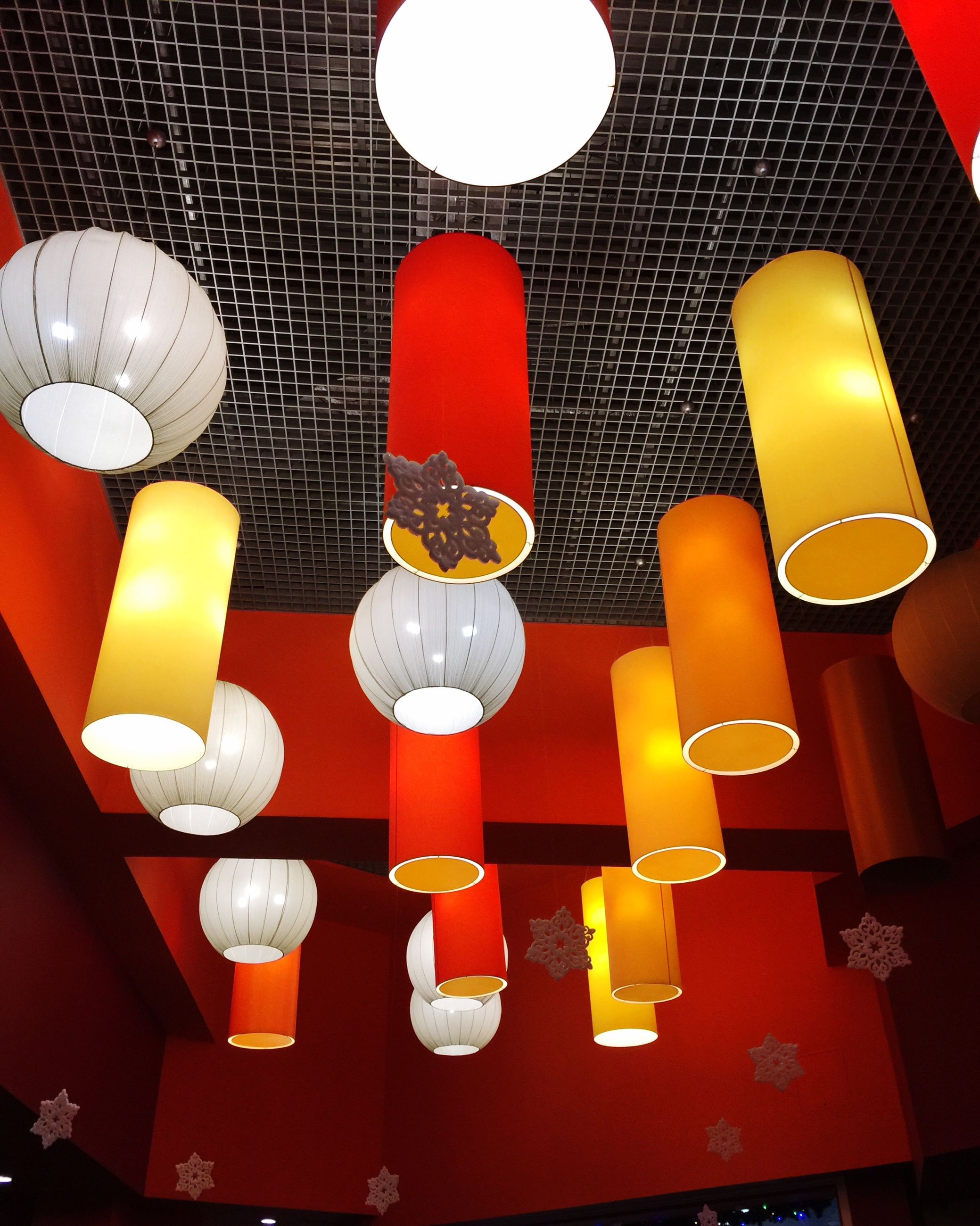 illuminated, lighting equipment, indoors, hanging, decoration, electric lamp, ceiling, low angle view, lamp, lantern, electric light, electricity, in a row, table, arrangement, no people, lit, wall - building feature, variation, red