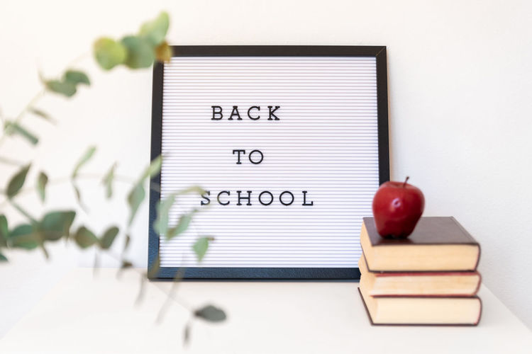 Back to school notice on message board Board Message White White Background Isolated School Education Class Apple Books Plant Text Book Publication Indoors  Spiral Notebook Note Pad Learning Western Script No People Communication Paper Close-up Fruit Preparation  Business Apple - Fruit To Do List Studying