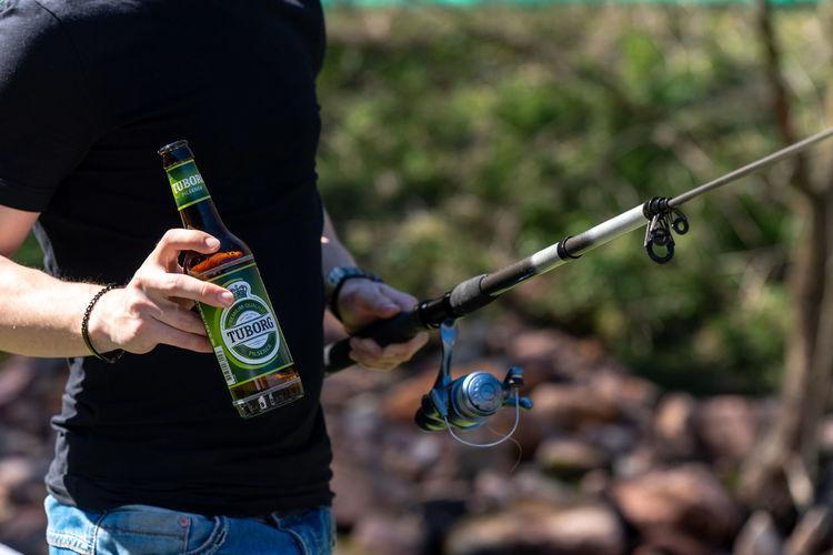 fishing with Tuborg Beer Tuborg Tuborg Beer Exploring Fun Human Hand Close-up Fishing Rod Fishing Fishing Pole Fisherman Trawler Catch Of Fish