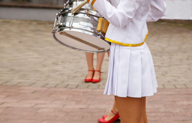 Musicians performing on street in city