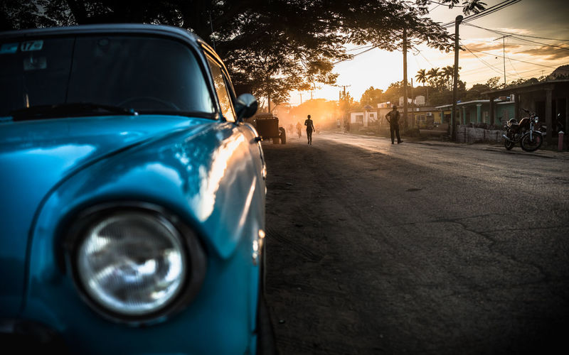 Car Parked On Road During Sunset