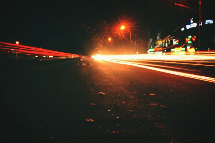 My heart burns for this city. Night Speed Road Light Trail Illuminated Long Exposure Street Transportation Motion Traffic Car City Street Street Light Blurred Motion City Outdoors No People High Street Creativity Getting Inspired Indianphotography Pixelart Photography Indianphotographer Nightphotography