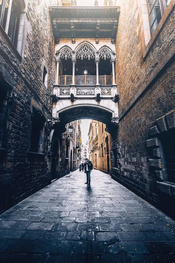 throw back barça days Streetphotography EyeEmNewHere SPAIN Catalunya Old Town Barcelona Architecture Built Structure Wet Building Exterior Real People The Way Forward City Transportation Building Day Outdoors Direction Walking The Art Of Street Photography