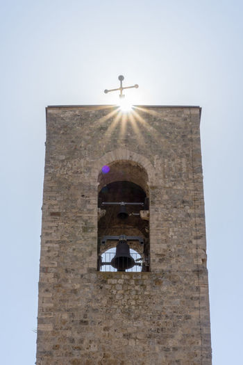 San Gimignano Tuscany Against The Sun Arch Architecture Belief Building Building Exterior Built Structure Clear Sky Cross Day History Italy Low Angle View No People Outdoors Place Of Worship Religion Sky Spire  Spirituality Sunstar The Past Tower