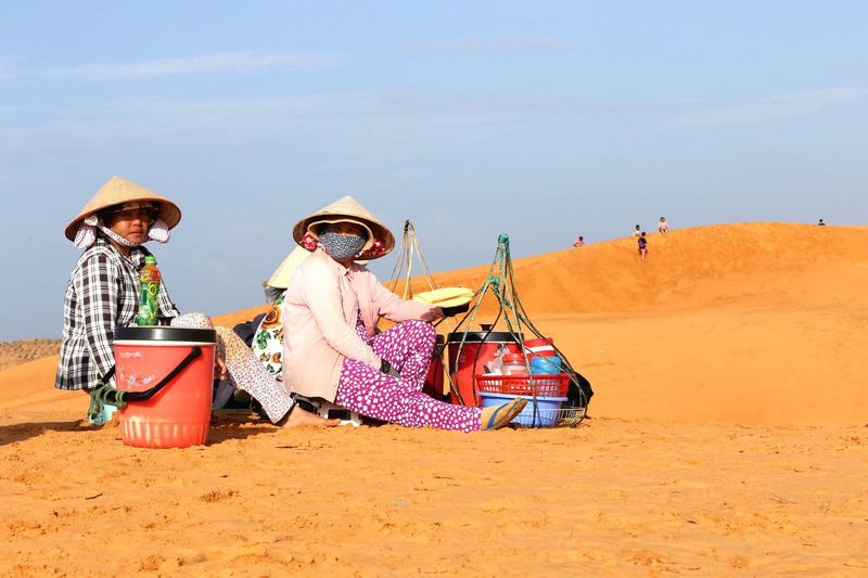 EyeEm Selects Desert Women Hawker Sand Real People Outdoors Day Sand Dune Togetherness Lifestyles Beach Sun Hat Full Length Boys Sky Childhood Water Friendship Sand Pail And Shovel People Adult