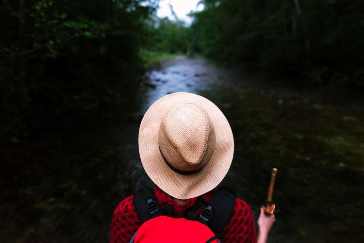 Portrait of man wearing hat against river