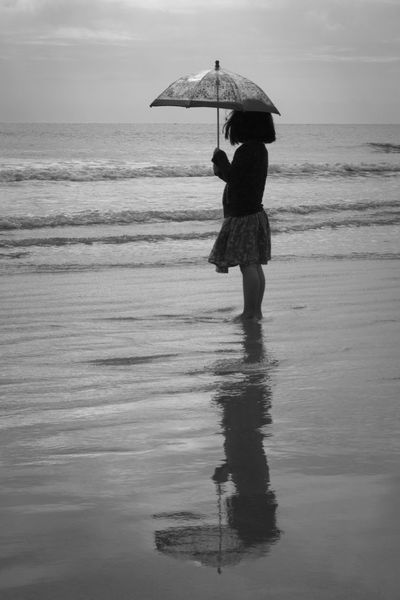 little umbrella for little girl Beach Beach Day Beach Photography Full Length Jetty Park Little Girl Little Umbrella Nature One Person Outdoors Real People Reflection Silhouette Standing Water