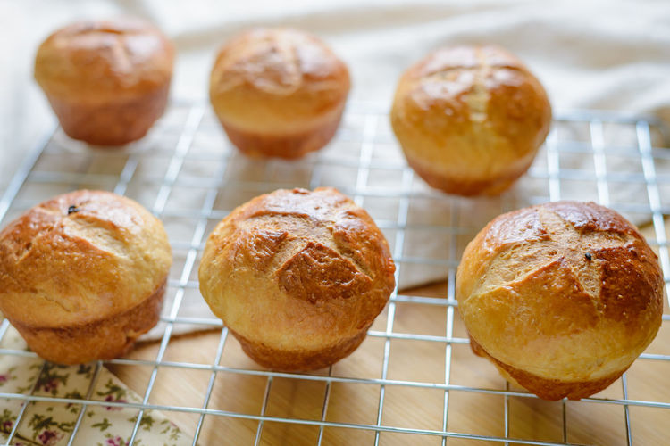 High angle view of muffins on cooling rack at table